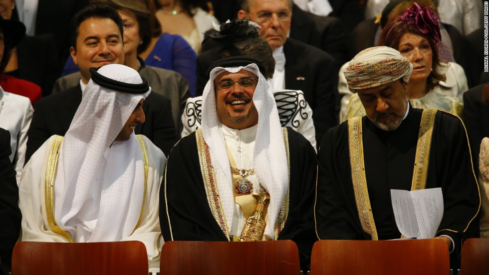 Emirati businessman Sheikh Hamed bin Zayed al Nahyan, left, attends the investiture ceremony.