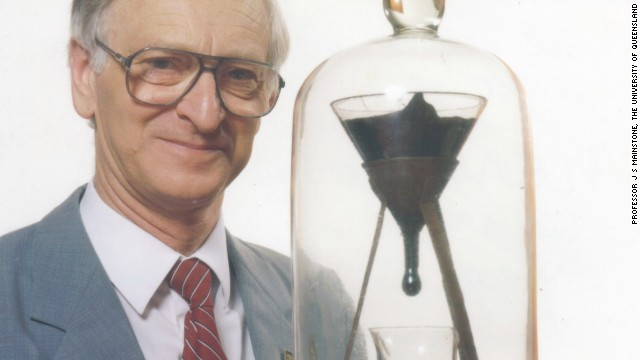 Professor John Mainstone with the eighth drop in late 1990, about 2-1/2 years after the seventh drop fell.