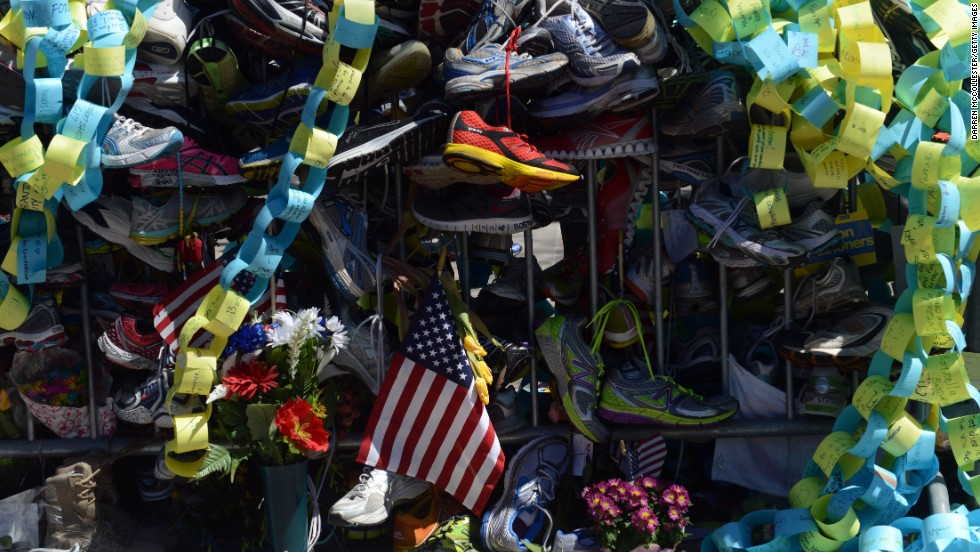 Running shoes are among the mementos left as a tribute to the victims of the bombing.