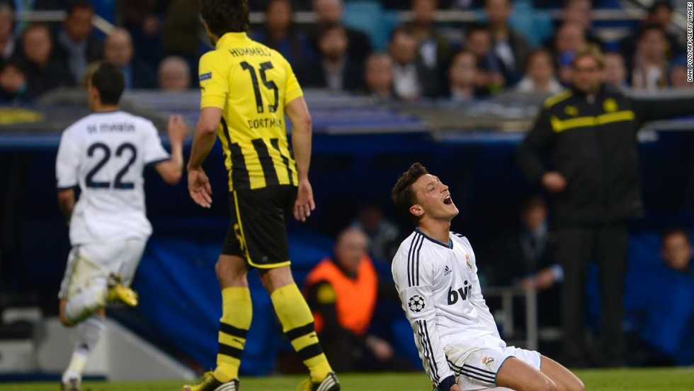 Mesut Ozil reacts after missing a glorious opportunity to give Real the lead after breaking clear of the Dortmund defense only to drill his effort wide of the post.