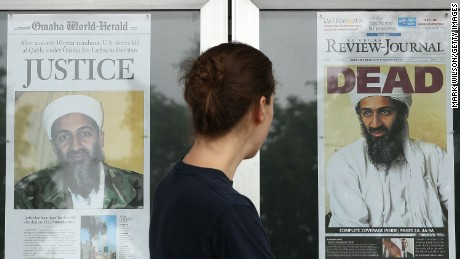 A passerby looks at news headlines in front of the Newseum in Washington in 2011.