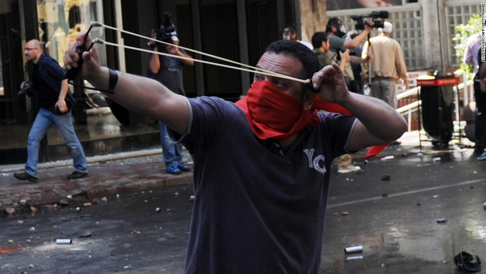 A May Day protestor uses catapults during clashes in Istanbul.
