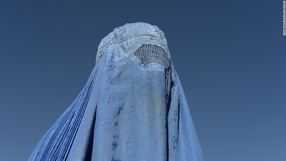 MAY 02 - KABUL, AFGHANISTAN: An Afghan woman takes part in a pro-democracy demonstration condemning the victory of former mujahideen groups that led to the start of Afghanistan's 1992-1996 civil war. Tens of thousands of civilians were killed in the conflict.