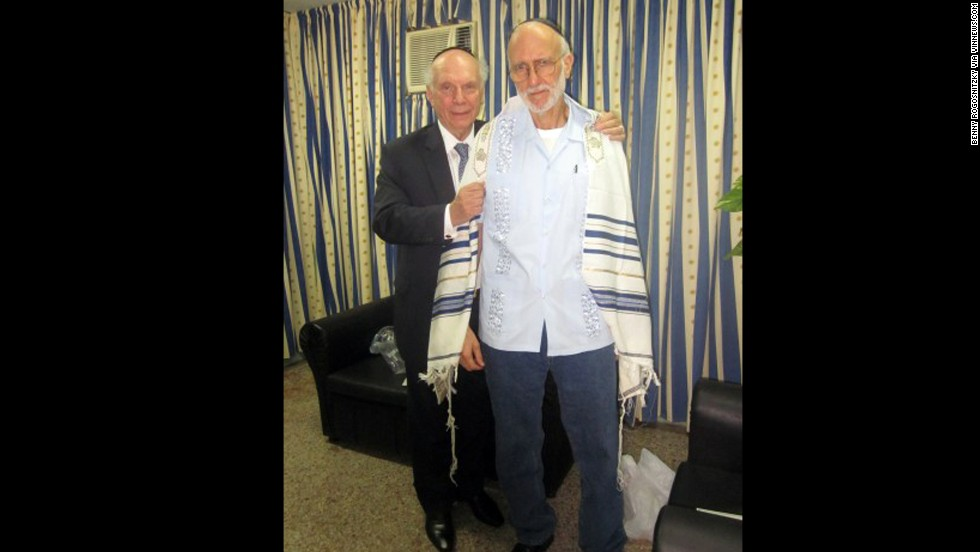 "Gross, at right with Rabbi Arthur Schneier was jailed while working as a subcontractor in Cuba in December 2009. Cuban authorities say Gross tried to set up illegal Internet connections on the island. Gross says he was just trying to help connect the Jewish community to the Internet. Former President Jimmy Carter and New Mexico Gov. Bill Richardson both traveled to Cuba on Gross' behalf. He was eventually <a href=""http://www.cnn.com/2014/12/17/politics/cuba-alan-gross-deal/index.html"" target=""_blank"">released in December 2014</a>."