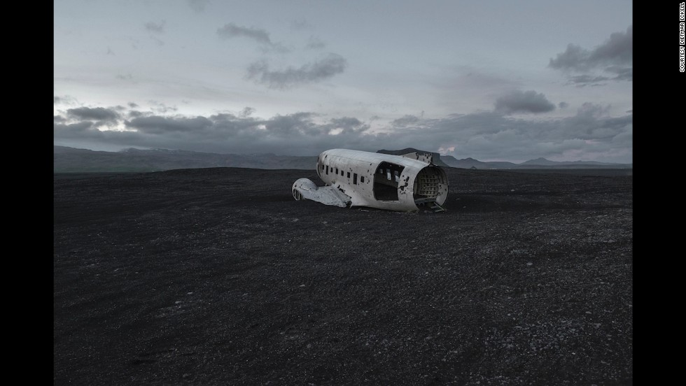 "The fuselage of a Douglas C-47 is covered in dust in a vast Icelandic landscape. Taking such photographs sometimes requires inconvenience. ""You have to be willing to spend long hours traveling with very little comfort,"" says Eckell. ""Like hike with all your gear for a few days and wait for days if no local transport is available."" <br /><br />The German photographer has encountered polar bears and snakes while making his way to remote areas to find abandoned remains."