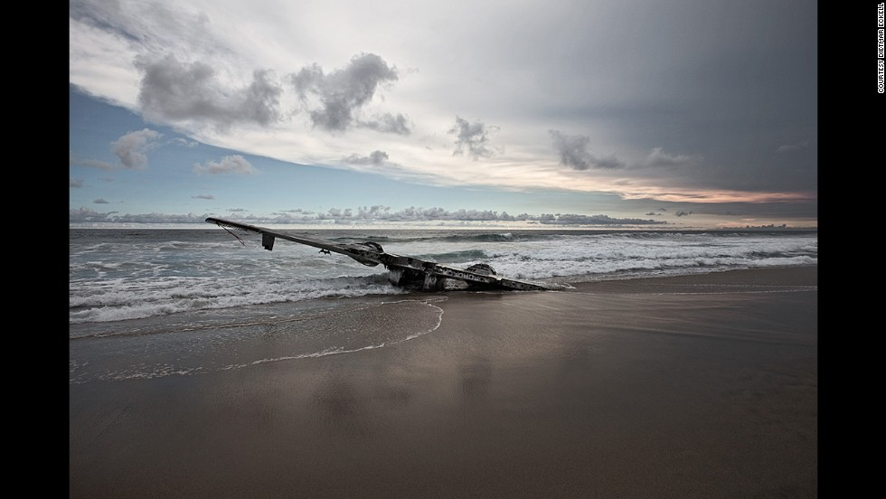 "The photographer uses the Internet, forums, archives and Google Earth to find the aircraft. ""Once in the area, I ask local pilots for information on the story and location,"" says Eckell. Here a Grumman HU-16 Albatross wing rests in the surf on Mexico's Pacific Coast. It wrecked in 2004."