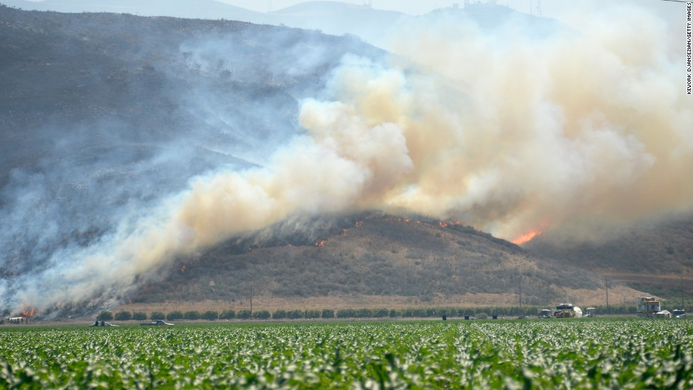The wildfire burns in Camarillo on Thursday. Nine miles of the Pacific Coast highway have been closed between the ocean and the Santa Monica Mountains.