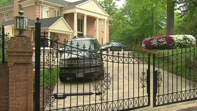 Two women removed from diplomat's home
