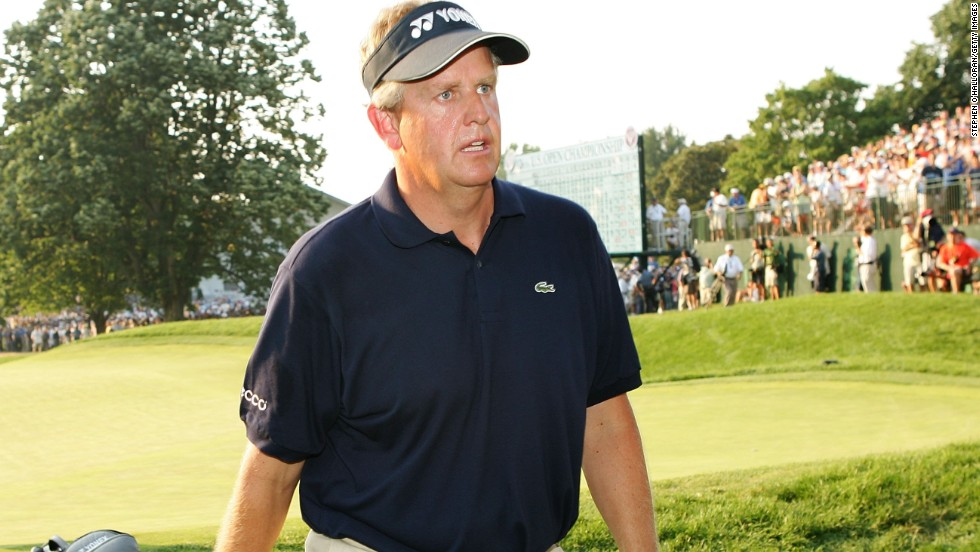Colin Montgomerie is left to reflect on another major near miss as he trudges off the 18th at Winged Foot in the 2006 U.S. Open after a double bogey six cost him victory.