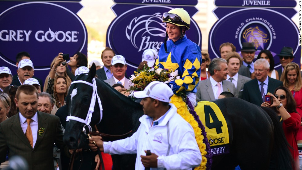 Napravnik and Shanghai Bobby are led into the winner's circle after winning the Breeder's Cup Juvenile race.