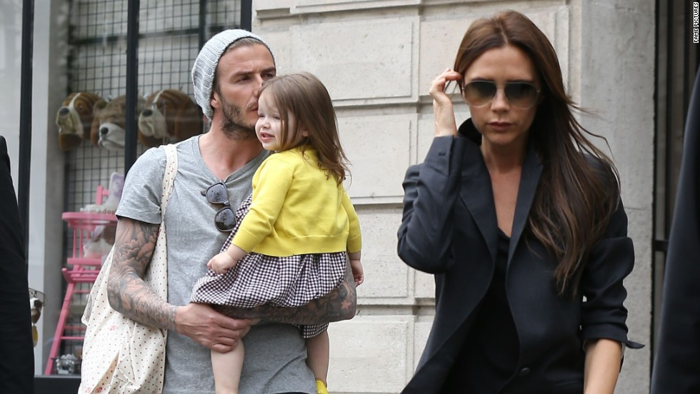 David and Victoria Beckham step out with daughter Harper on May 3.