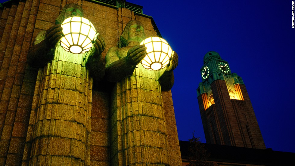 Created by Emil Wikström, four granite giants who flank the Helsinki station's main entrance carry enormous globe lamps to light the way for its 200,000 daily passengers.