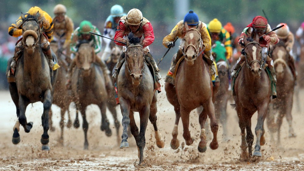 Joel Rosario riding Orb, center, comes down the final stretch.