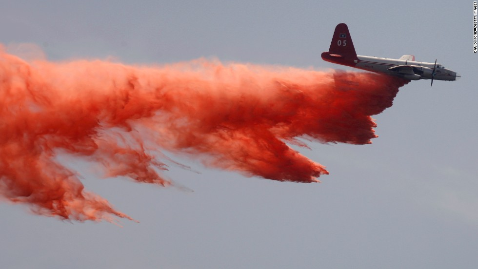 A tanker plane drops fire retardant to control the Springs Fire in Camarillo on Saturday, May 4.