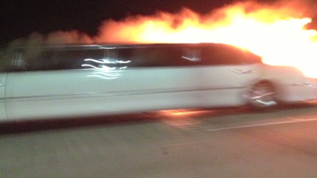 Flames engulf limo, trap passengers