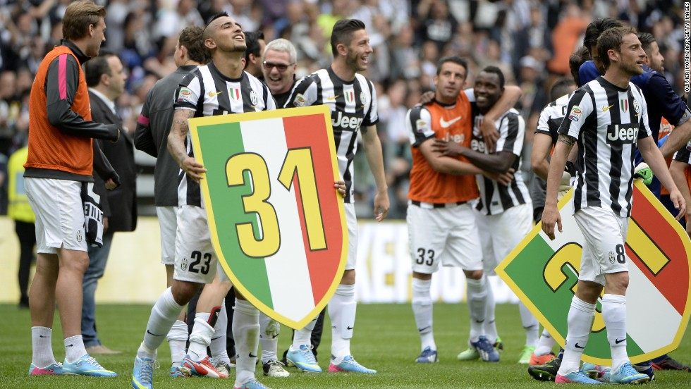 Arturo Vidal, who scored the winning goal from the penalty spot, holds a placard bearing the number 31 -- referring to the two titles Juve lost due to a match-fixing scandal.