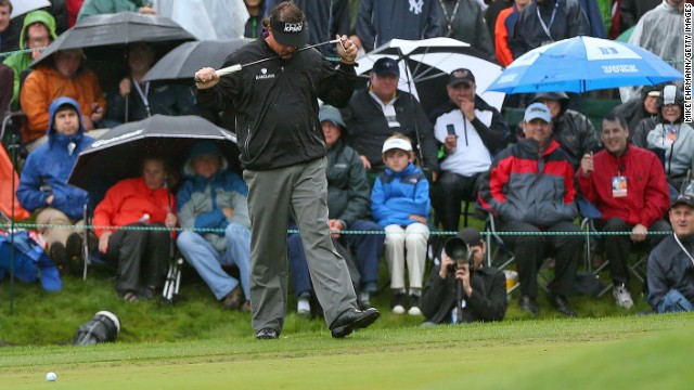 Phil Mickelson reacts to missing a birdie putt on the 18th hole at Quail Hollow, which meant he missed a playoff .