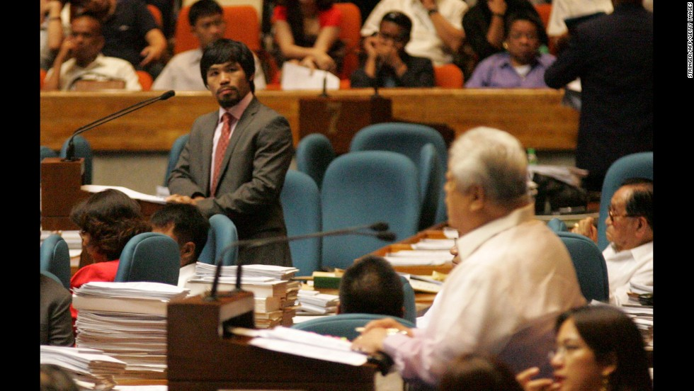 Pacquiao looks toward Congressman Edcel Lagman, right, at the House of Representatives on May 18, 2011.