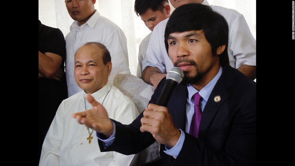 Pacquiao speaks at a news conference during the Catholic Bishops Conference of the Philippines in May 2011.