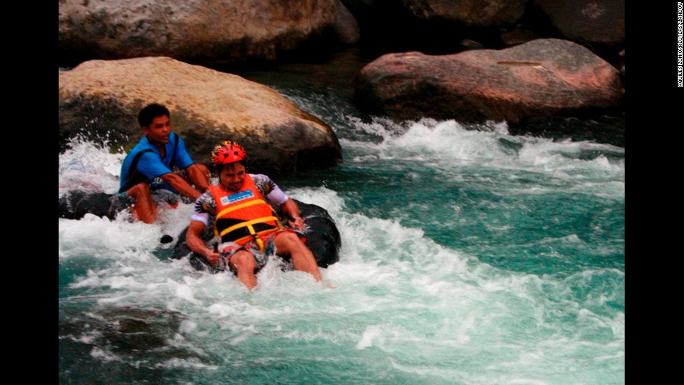 Pacquiao tries out whitewater rafting to promote tourism in his district in New La Union in Maitum, Sarangani province, on August 14, 2010.