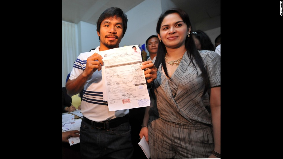 Pacquiao poses with his certificate of candidacy next to his wife, Jinkee, after filing in the town of Alabel, Saragani province, on December 1, 2009.