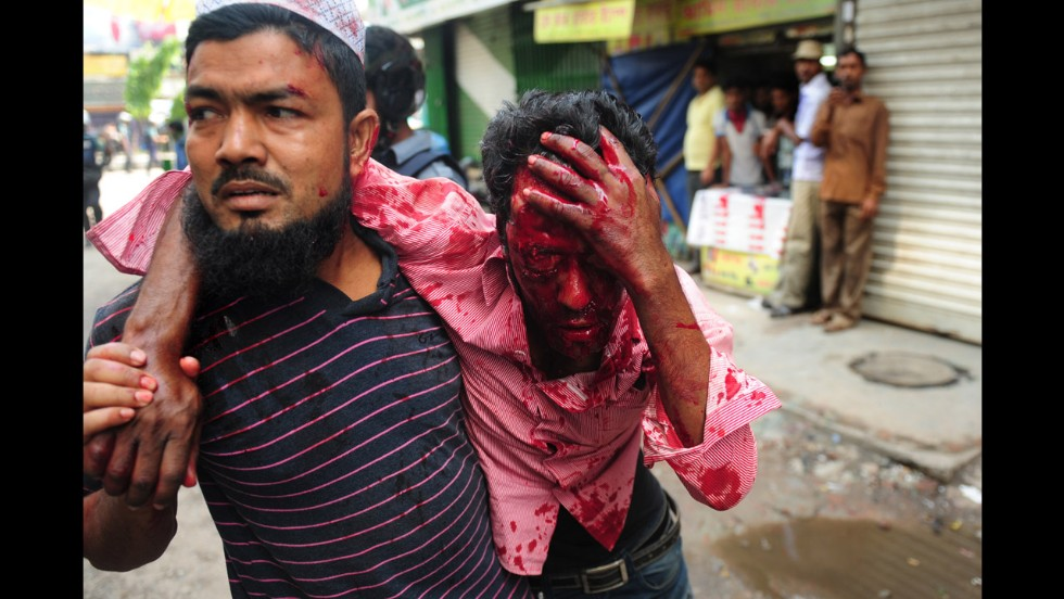 Civilians carry an injured protester on May 5.