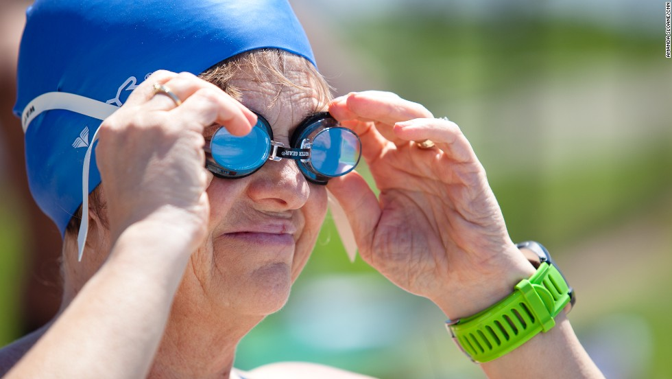 Timme adjusts her goggles before jumping into the pool at the National Training Center.