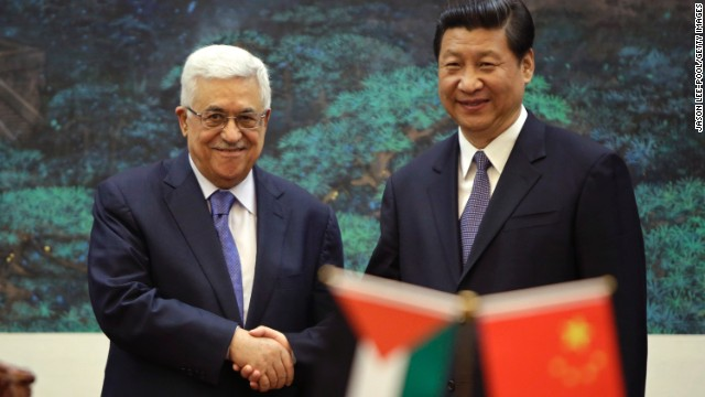 Palestinian Authority President Mahmoud Abbas shakes hands with Chinese President Xi Jinping on May 6, 2013.