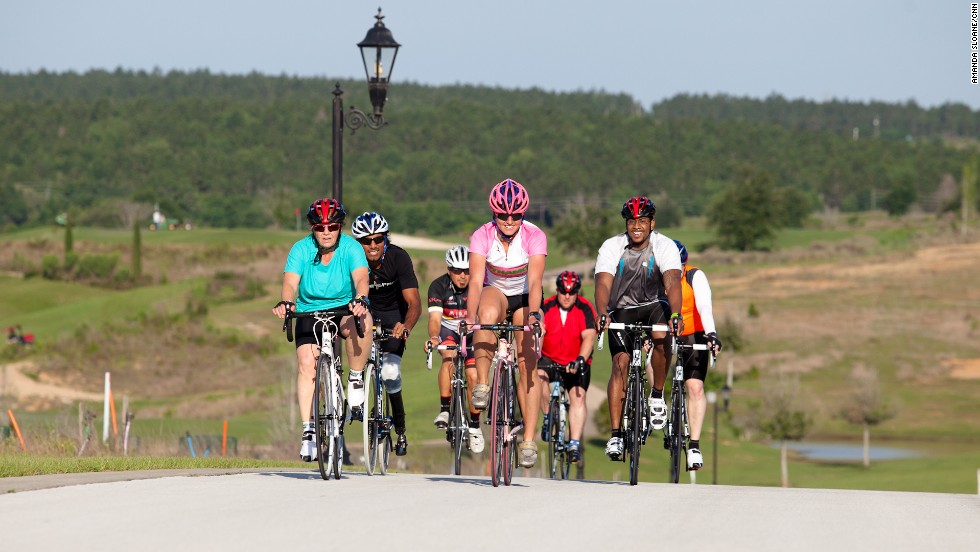 The Fit Nation team tackles a long bike ride during training.