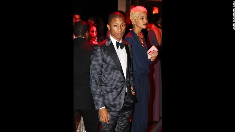 Musician Pharrell Williams and designer Helen Lasichanh attend the gala.