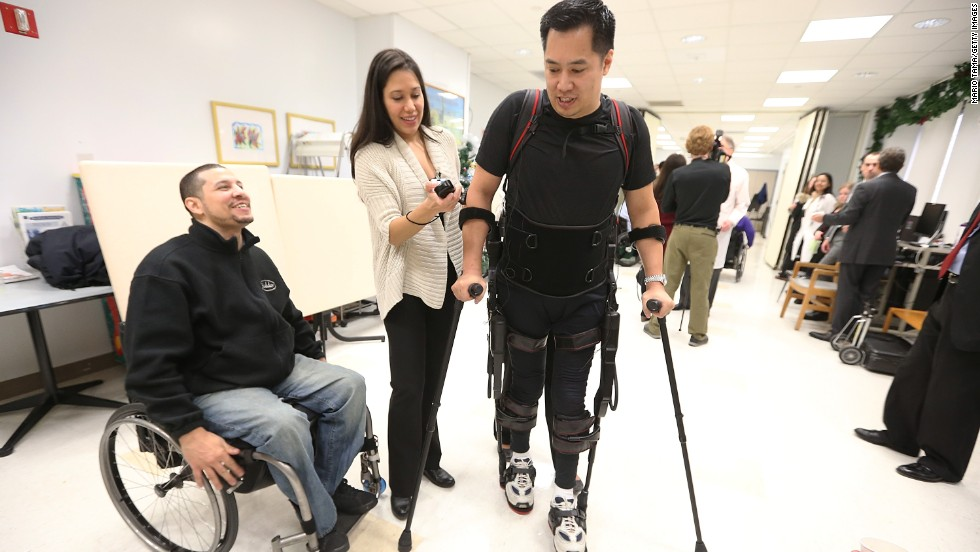 Ekso Bionics is also developing exoskeletons for rehabilitation. Here, Architect Robert Woo takes his first steps since a construction accident paralyzed him from the waist down.