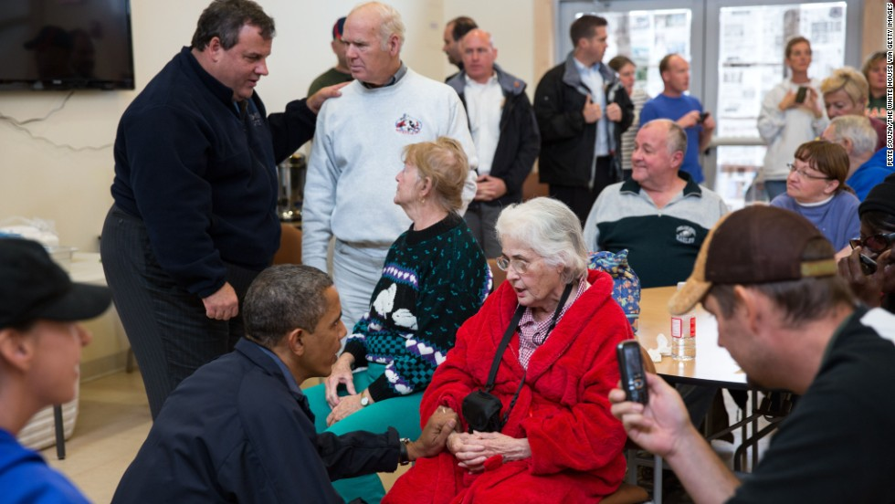 President Barack Obama and Christie talk with local residents affected by Hurricane Sandy at the Brigantine Beach Community Center on October 31, 2012, in Brigantine, New Jersey, in this photo provided by the White House.