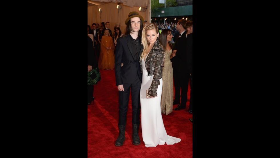 Tom Sturridge and Sienna Miller attend the gala.