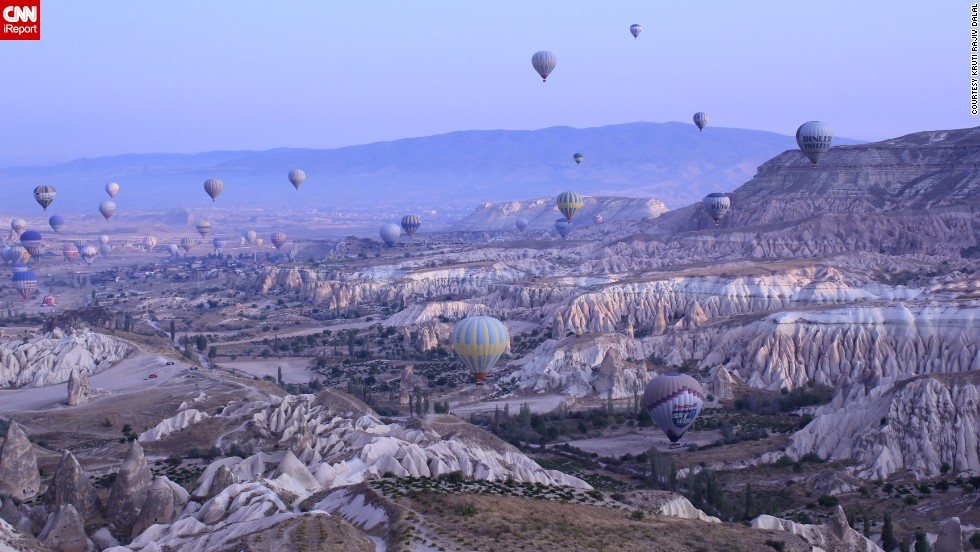 "<a href=""http://ireport.cnn.com/docs/DOC-912180"">Kruti Rajiv Dalal</a> watched dawn break during a hot air balloon ride in Cappadocia, Turkey. ""It's hard to sum up the experience in words,"" she said. ""But the first one that comes to mind is that it was surreal."""