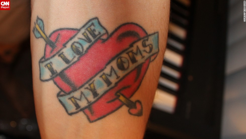 "Kyle Divine <a href=""http://ireport.cnn.com/docs/DOC-967247"">honors both his moms</a> with a tattoo he got on his arm on Mother's Day in 2006. ""My moms were the best role models I had while I was growing up, regardless of sexual orientation,"" he said. ""I got the tattoo to show them and the world that I am proud to have them as my parents."" It also has a more subtle meaning: ""Without actually saying it, the tattoo says that I am a supporter of gay rights."" Divine says both his moms love the ink."