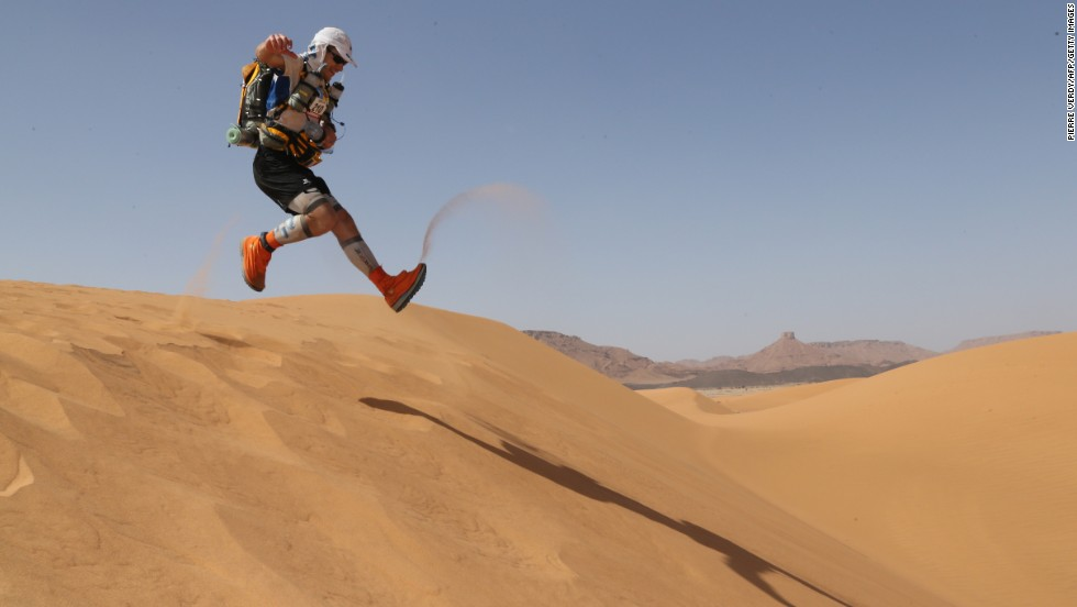 A competitor runs down a sand dune on April 10 during the 28th annual Marathon des Sables. Participants from around the world traverse the Moroccan Sahara for seven days with all their equipment and food on their backs. The ultramarathon is considered the toughest foot race on Earth.