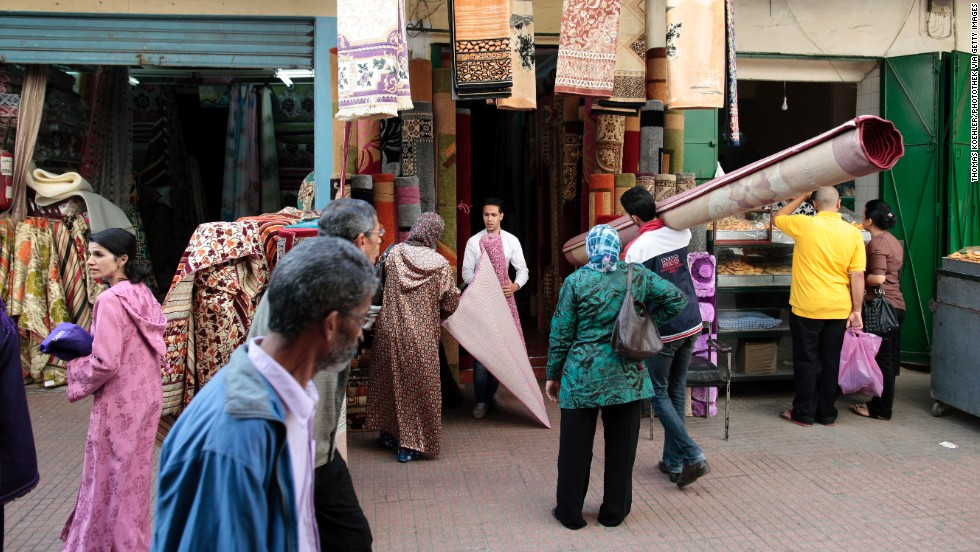 Carpet sellers speak with customers in the old town of Rabat on October 31, 2011.