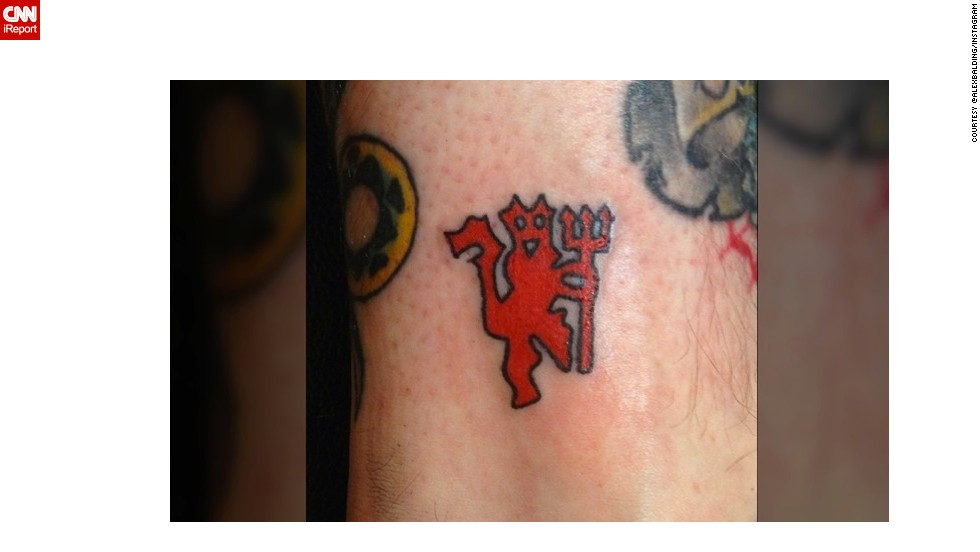 """Lifelong fan"" @alexbalding shows his red devil tattoo -- Red Devils is the club's nickname -- done the very morning of the announcement Ferguson was to retire. He said he was ""devastated"" by the news."