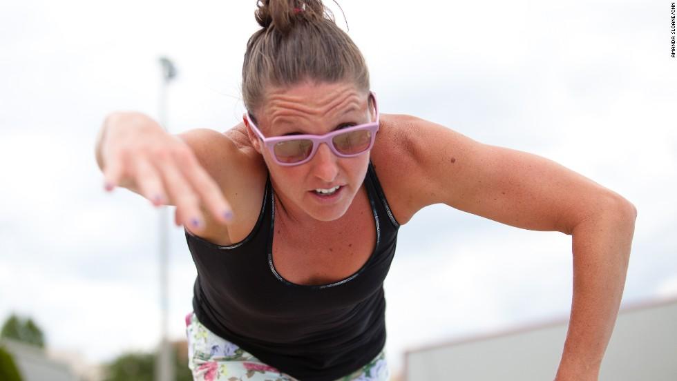 Coach April Burkey instructs the team on proper stroke techniques.