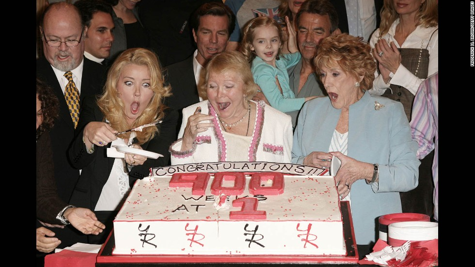 "Cooper, right, celebrates the 900th week of ""The Young And The Restless"" as the No. 1 rated daytime drama with fellow cast members on April 6, 2006."