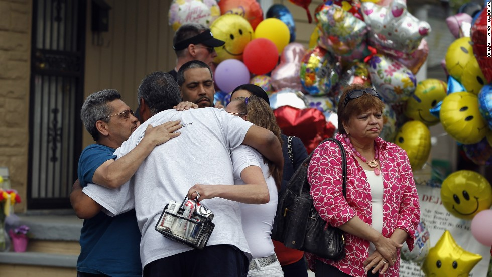 "Relatives of kidnapping victim Georgina ""Gina"" DeJesus hug after she returned to her parents' home in Cleveland on May 8."