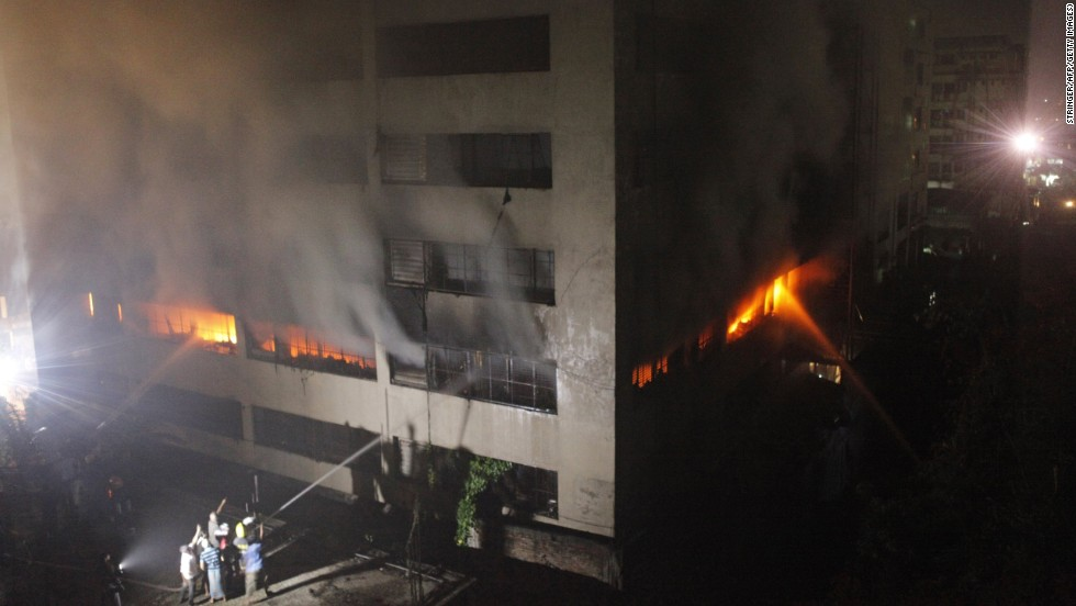 """Bangladeshi firefighters attempt to extinguish a blaze at a garment factory in Dhaka early on Thursday, May 9. At least seven people were killed in the latest tragedy in Bangladesh's textile industry. Bodies are still being  pulled from the rubble of <a href=""""http://www.cnn.com/2013/04/24/asia/gallery/bangladesh-building-collapse/index.html"""" target=""""_blank"""">a  garment factory that collapsed</a> on April 24, killing at least 900 people."""