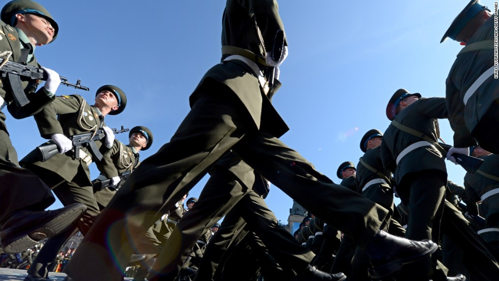 MAY 09 - MOSCOW, RUSSIA: Russian soldiers march in Red Square during a Victory Day parade. Fighter jets scream overhead and heavy tanks rumble over cobblestones as Russia flexes its military muscle on the anniversary of its costly victory over Nazi Germany in World War II.