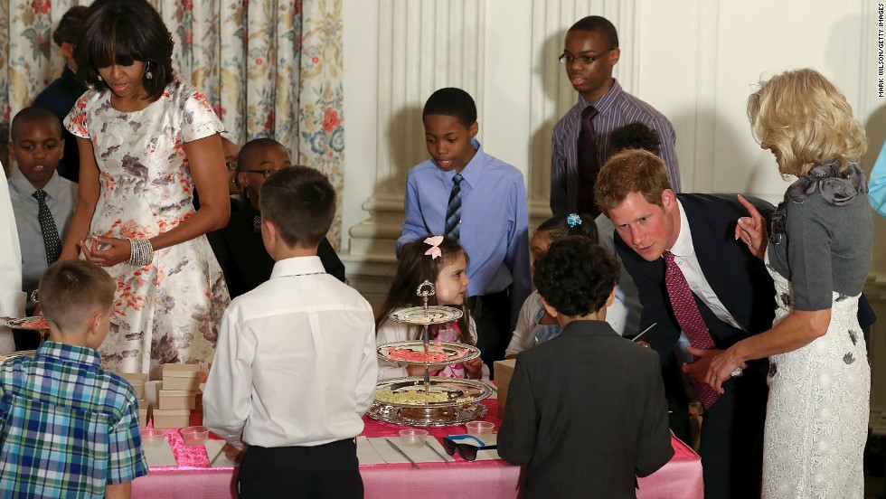 Harry talks to young children during an event at the White House on May 9 to honor military families. First lady Michelle Obama was host.