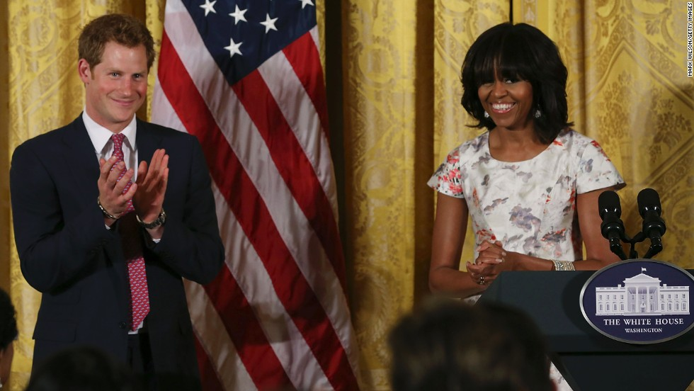 Harry stands with Michelle Obama during his White House visit on May 9.