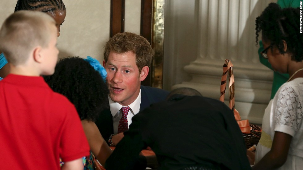 Harry talks to children of military families at the event hosted by Michelle Obama.
