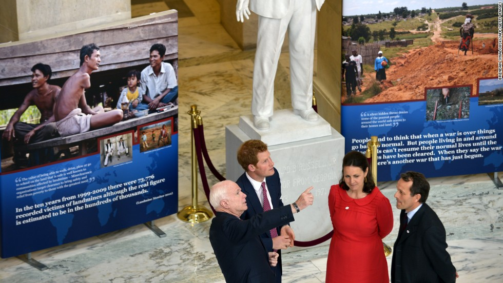 Sen. John McCain gestures while touring the exhibit with Prince Harry. It was sponsored by the HALO Trust, a British-based group that works to deactivate mines.