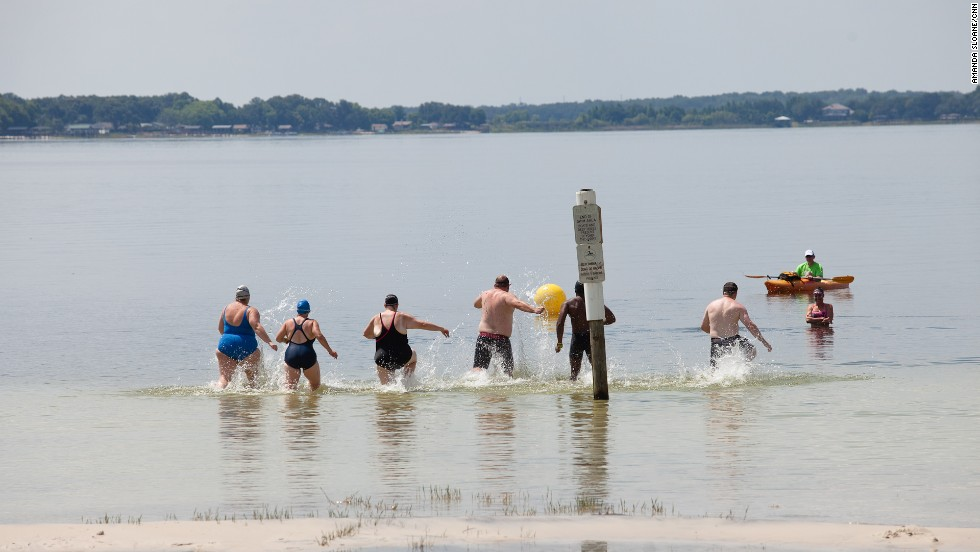 """Members of the """"6-Pack"""" practice racing into the water before their first ocean swim."""