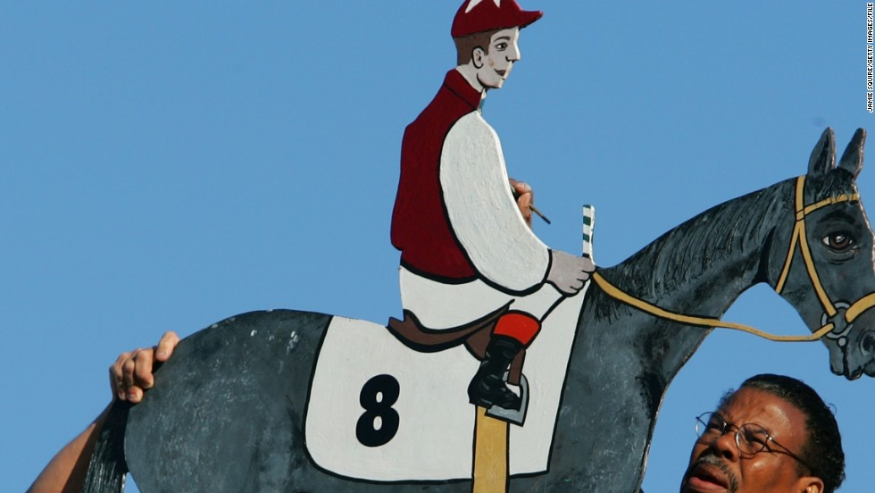 Each year the weather vane atop Pimlico Race Course's Old Clubhouse is painted in the winning jockey's colors. The unusual tradition started in 1909 after the building's original arrow-shaped weather vane was struck by lightning and replaced with an ornamental iron rider and horse.