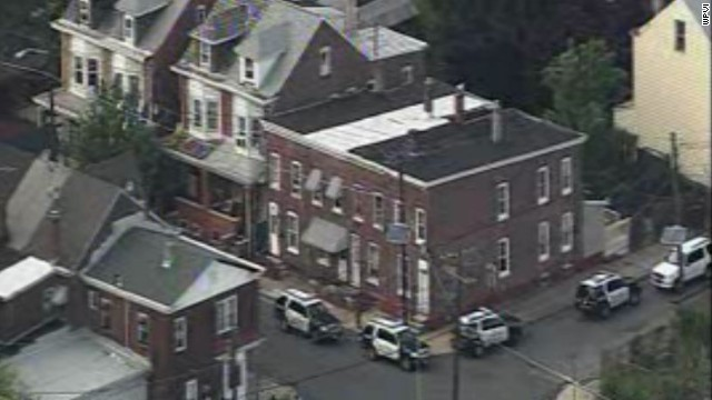 Police surround the scene where a gunman barricaded himself with three children in Trenton, New Jersey.